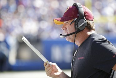 Redskins head coach Jay Gruden stands on the sidelines
