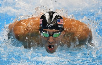 USA's Michael Phelps swims for a silver medal tie during the Men's 100M Butterfly at the 2016 Rio Olympics