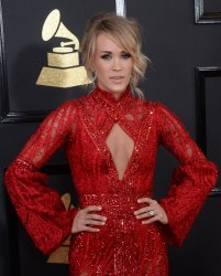 Carrie Underwood arrives for the 59th annual Grammy Awards in Los Angeles