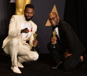 Tarell Alvin McCraney and Barry Jenkins appear backstage with their Oscars at the 89th annual Academy Awards in Hollywood