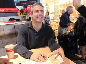 Andy Cohen signs new book
