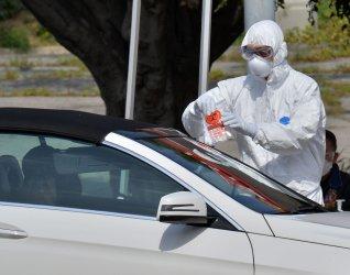 Medical personnel distribute self-testing coronavirus kits in Los Angeles