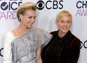 Portia De Rossi and Ellen DeGeneres backstage at the People's Choice Awards in Los Angeles