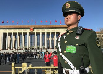 A Chinese soldier stands watch at the CPPCC in Beijing, China