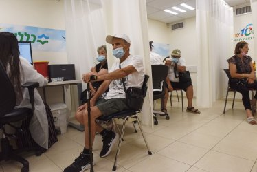 Elderly Israeli Wait For A Third  COVID-19 Vaccine In Jerusalem