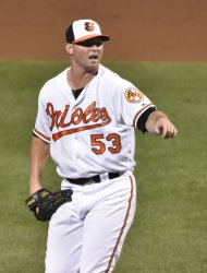 Baltimore pitcher Zach Britton reacts after delivering to Toronto in the ninth inning