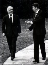 Jordan's King Hussein and President Reagan walk from the Oval Office