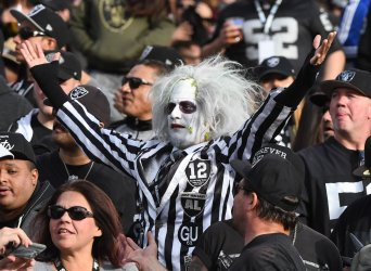 Raiders fans celebrate victory over Panthers in Oakland