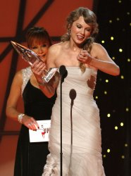 Taylor Swift wins Entertainer of the Year at the 2011 CMA Awards in Nashville