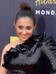 Francia Raisa attends the 2018 MTV Movie & TV Awards in Santa Monica, California