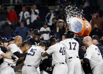 Yankees Mark Teixeira celebrates after a grand slam