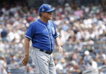 Royals manager Ned Yost walks back to the dug