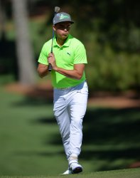Rickie Fowler reacts after hitting a chip shot at the Masters