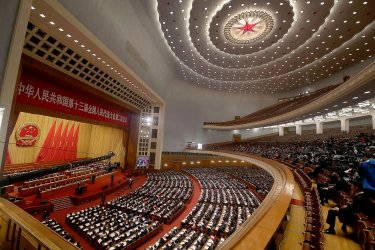 Li delivers work report to delegates during the NPC in Beijing, China