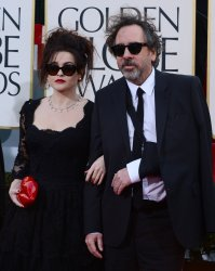 Actress Helena Bonham Carter and director Tim Burton attend the 70th annual Golden Globe Awards in Beverly Hills, California