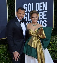 Alex Rodriguez and Jennifer Lopez attend the 77th Golden Globe Awards in Beverly Hills