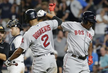 Boston Red Sox Rafael Devers hits a game tying home run