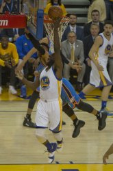 Warriors Draymond Green  takes the ball to the basket