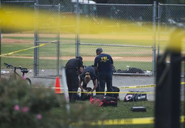 Investigators work near Simpson field where a gunman opened fire in Alexandria, Va.