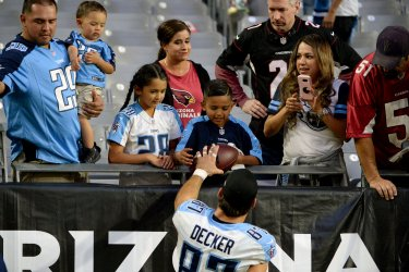 Titans' Decker gives a young fan a ball