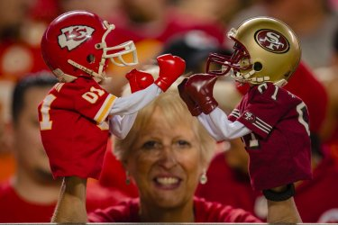 A Chiefs fan shows off her boxing NFL puppets
