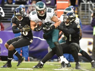 Eagles' Zach Ertz picks up short gain in front of Ravens' Tavon Young and C.J. Mosley