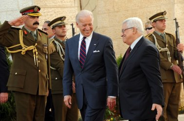 US Vice President Joe Biden laughs with Palestinian President Mahmoud Abbas on his departure from the presidential compound in Ramallah, West Bank