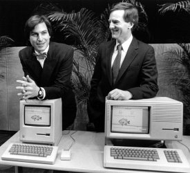 Steve Jobs and John Sculley displaying the new Macintosh and Lisa 2 desk top computers.