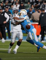 Los Angeles Chargers'Thomas Davis Sr (R) breaks up a pass to Oakland Raiders DeAndre Washington