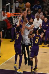 Timberwolves center Karl-Anthony Towns shoots over Lakers center JaVale McGee