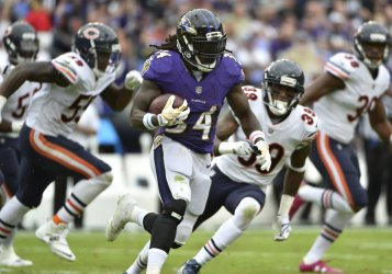 Ravens' Alex Collins runs 30 yards for a first down against Bears