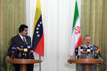 Iran's President Mahmoud Ahmadinejad meets Venezuela's Foreign Minister Nicolas Maduro in Tehran