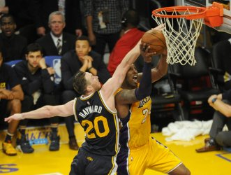 Los Angeles Lakers Kobe Bryant goes up for a basket in the second half in his final game