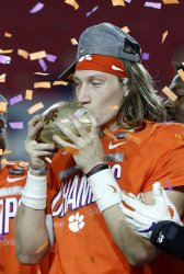 Clemsons Lawrence kisses the trophy after win over Ohio State in the Fiesta Bowl