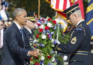 Obama Lays a Wreath at the Tomb of the Unknown Soldier