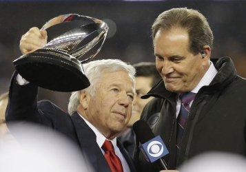 Patriots owner Robert Kraft hold the Lamar Hunt Trophy