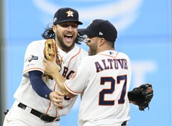 Astros Marisnick and Altuve celebrate winning in ALDS game five in Houston