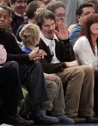 Ethan Hawke reacts with his son at Madison Square Garden in New York