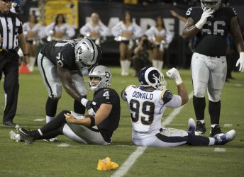 Raiders QB Derek Carr loses to Rams