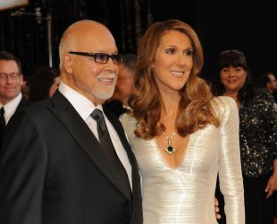 Singer Celine Dion and husband and manager Rene Angelil arrive at the 83rd annual Academy Awards in Hollywood