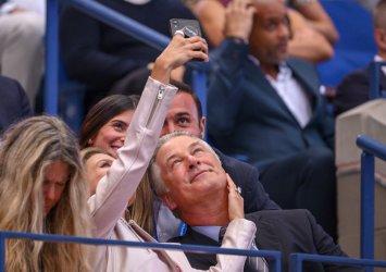 Alec Baldwin smiles at the US Open