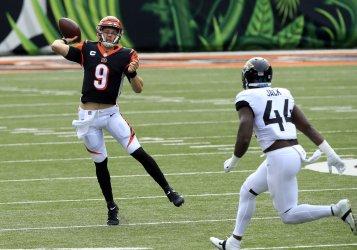 Bengals Joe Burrow Throws under Pressure from Jaguars Myles Jack
