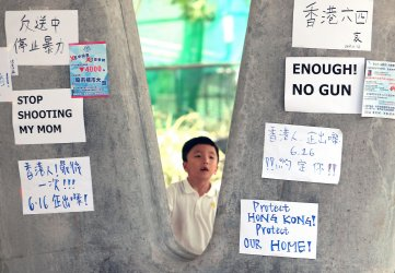 Protest signs still hang on walksways in Hong Kong