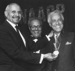 Gov. Douglas Wilder receives 1990 NAACP Award