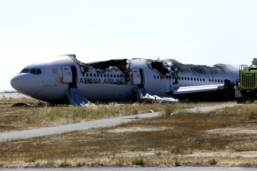 View of damage to fuselage of Asiana Flight 214