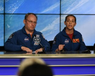 NASA Astronauts Mike Finke and Nicole Mann attend post-launch press conference at the Kennedy Space Center.