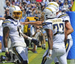 Chargers' Keenan Allen celebrates with teammates after scoring a touchdown
