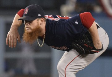Red Sox pitcher Kimbrel takes his stance in Game 3 of the World Series