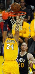 Los Angeles Lakers Kobe Bryant goes up for a basket in his last game