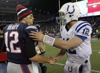 Patriots Brady and Colts Luck shake hands at Gillette Stadium in Foxboro, MA